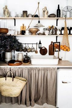Ready for some inspo? Scroll ahead for 14 modern ways to incorporate cabinet curtains into your kitchen remodel today. #hunkerhome #kitchencabinet #kitchencabinetideas #cabinetideas #skirtedcabinets Boho Kitchen, Kitchen Styling, Rustic Kitchen, Country Kitchen, Kitchen Decor, Kitchen Ideas, Kitchen Gifts, Small Space Kitchen, Small Spaces