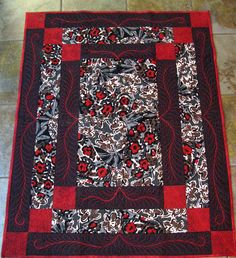 Name:  CONCENTRIC FRAME QUILT.jpg Love the FMQ in the borders in addition to showing off the fabric.