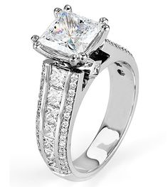 From Michael M. Collection Princess side bezels add hidden detail to this platinum Engagement Ring, featuring channel-set princess cut diamonds and rows of pave-set diamonds adding shine to the sides of the ring. Also available in 18k white, yellow, and rose gold.