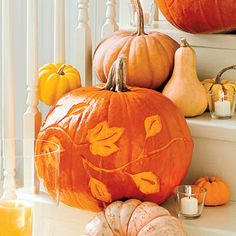 Etching will leave an artful design on your pumpkin. The technique allows your pumpkin to last longer and is less messy than traditional carving. Click through for templates | SouthernLiving.com
