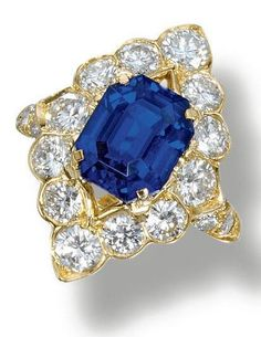 Sapphire and diamond ring, Van Cleef & Arpels.   The step-cut sapphire set within a brilliant-cut diamond surround , mounted in 18 carat yellow gold.