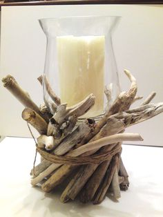 Driftwood centerpiece with candle. Can't see paying $90 for it, but I can make it on the cheap. Love the idea!