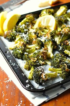 The best broccoli you will ever have! Roasted with garlic, olive oil, lemon and parmesan. So simple....it's like MAGIC!