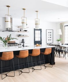 black and white kitchen design leather barstool industrial modern kitchen gold and white endnote lights black kitchen island Home Decor Kitchen, Kitchen Interior, New Kitchen, Kitchen Dining, Kitchen Modern, Modern Kitchens, Interior Livingroom, Minimalist Kitchen, Design Kitchen