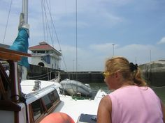 Taking Ladyhawke through the Miraflores locks, Panama Canal.  Serious and sometimes dangerous business, Joie intent on handling the lines. Please like us on fb: https://www.facebook.com/EveryoneSaidIShouldWriteABook