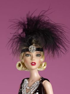 Emma Jean's Extravagant Night Out | Tonner Doll Company *Emma is so enticing. I love her feather headband and her pouty red lips.
