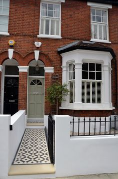 front garden Plastered rendered front garden wall painted white metal wrought iron rail and gate victorian mosaic tile path in black and white scottish pebbles York stone balham london Victorian Front Garden, Victorian Front Doors, Victorian Terrace House, Victorian Homes, Victorian House London, Victorian House Interiors, House Front Door, House Entrance, Terrace House Exterior