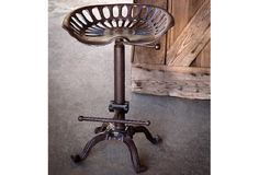 Adjustable Height Tractor Seat Stool - From Antiquefarmhouse.com - http://www.antiquefarmhouse.com/past/cast-iron7/metal-tractor-seat-stool.html