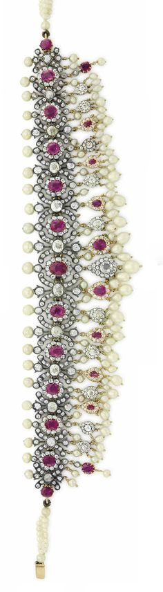 AN ANTIQUE RUBY, SYNTHETIC RUBY, DIAMOND AND PEARL CHOKER. Designed as a graduated series of oval-cut rubies and one synthetic ruby, within rose-cut diamond surrounds, alternating with old-cut colored diamonds within x-form surrounds, set at the top with pearls, suspending a fringe of similar design, circa 1880, 11 3/4 ins., mounted in silver-topped gold