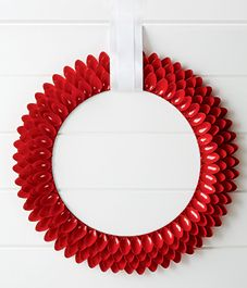DIY project: Red Plastic spoon wreath is a modern take on a classic wreath (via Style At Home)