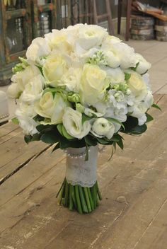 Bridal bouquet with roses, ranunculus, lisianthus, stocks and hydrangea. Designed by Forget-Me-Not FLowers.