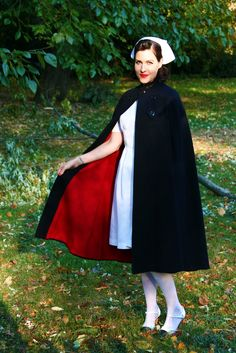 My 1940's nurse Halloween costume from yesterday. Wore my great aunt Jo's navy blue wool with red lining nurse's cape that has b...