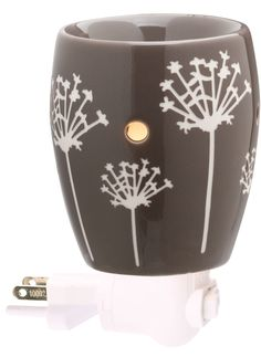 Taro Plug-In Scentsy Warmer    Taro features a contemporary dandelion pattern that pops against a deep gray background. Plug it in and watch it glow!  http://tonyascruggs.scentsy.us