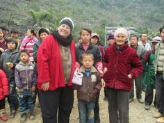 Wei Senbao lives in this village. Here he is with his grandmother and mother. His mother says he is doing much better. His cheek has not changed in a year's time. It is still larger than the other side, but no more growth. The scar in not noticeable.