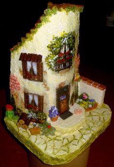 Coppo facciata di casa con giardinetto.
