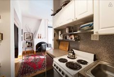 Stylish 325-sq-ft studio uses clever design to create the feel...