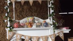 Amy's Allsorts Candy Cart  'Just Married' Shabby chic design in a barn. This looks fantastic against the hay backdrop . Materials like Hessian really emphasis this look.