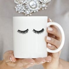 Add a little glam to your morning routine with our hand-drawn eyelashes coffee mug! Hand-drawn by Designer of Sweet Water Decor Melissa this piece is perfect to put your makeup brushes in or as a fu Gifts For Makeup Lovers, Gift For Lover, Gifts For Her, Diy Becher, Coffee Cups, Tea Cups, Drink Coffee, Coffee Coffee, Morning Coffee