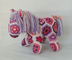 This horse is made of more than 40 african flowers motives (patches), all the patches are different. It is about 14 tall and 12 long and just adorable.