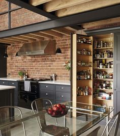 This industrial style shaker kitchen features exposed beams and contemporary brickwork as well as the latest cutting-edge appliances. Industrial Kitchen Design, Industrial House, Industrial Interiors, Industrial Metal, Industrial Kitchens, Industrial Lamps, Industrial Furniture, Vintage Industrial, Kitchen Larder Cupboard