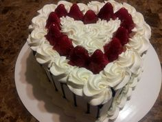 Heart shape cake with fresh strawberries