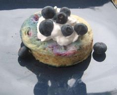 "Blueberry Flax Microwave Muffin    Mix ¼ cup oats, 1/4 cup fresh or frozen blueberries, 1 tsp baking powder, 2 tbsp ground flax, 2 tsp cinnamon, 2 egg whites, and a sprinkle of sugar (or other natural sweetener) in a microwave-safe bowl. Cook in the microwave for 1 minute (or longer if the muffin hasn't ""puffed"" up yet). Let cool, top with a dollop of yogurt & a sprinkle of blueberries!"