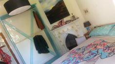I know it's mega cheesy, but we picked the turquoise out of the bedspread/ pilowcases and brought it through into the wardrobe to add the pop (well, in this case EXPLOSION) of colour we so wanted in our bedroom.