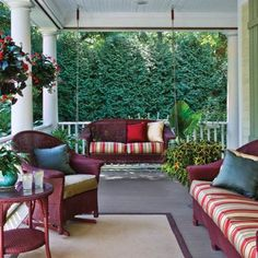 a porch with an evergreen screen