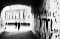 together - Two people with dog go through a small tunnel. They come from the river Spree in Berlin. In the background, the pillars of a museum. Abstract black / white street photography from Berlin. #street #streetphotography #blackandwhite #photography