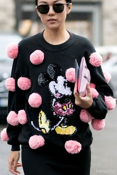 Pink pom-pom detail on this black Mickey Mouse sweater. Trendstop - trend analysis for fashion and creative professionals