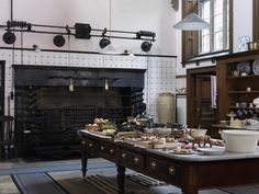 Tall ceilings with upper windows allows plenty of sunlight to flood into the kitchen | Lanhydrock | National Trust Images