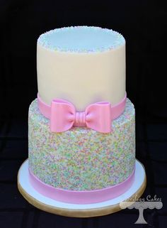 Pastel sprinkle themed cake with pink bow www.facebook.com/i.love.cuteology.cakes