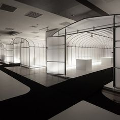 Five agricultural growing tunnels stand inside a former book store in Kanazawa, Japan, for this exhibition designed by Japanese studio Nendo. Created for the inaugural International Triennale of Kogei, the installation provides five exhibition spaces to be curated separately, without disturbing the shop fittings that remain in place. Each enclosure is lit from without the