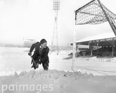 Groundsman Fred Eckersley, clearing deep snow around a goalmouth at Burnden Park, Bolton, where Bolton Wanderers are due to meet Wolverhampton Wanderers in the sixth round of the FA Cup.