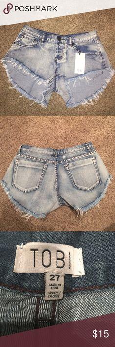 Light Wash High Waisted Shorts Light wash high waisted shorts, shorter in the front longer in the back, never worn with tag! Tobi Shorts Jean Shorts