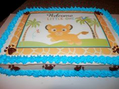 Babu Lion King Baby Shower Cake.    Without all the blue around the edge. Maybe with green.