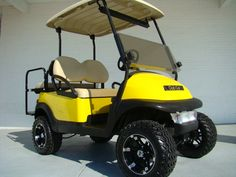 19TH HOLE GOLF CARTS - YELLOW LIFTED EZGO GOLF CART
