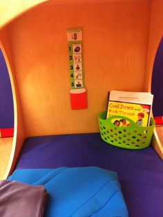 """""""Cool down"""" cube! This is where my students go to calm down. My cool down cube is equipped with a visual Velcro checklist on calming down, a weighted blanket/ vest, and a basket of social stories and picture books related to dealing with anger!"""