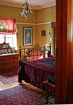 boho bedroom. The art and bedding are not my style, but the rest is so warm and inviting. Love the color on the walls, the moulding, the bed, the dresser...