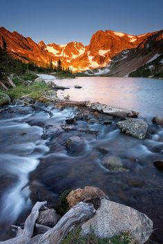 Indian Peaks Wilderness Area, near Nederland, Colorado are home to many alpine lakes and abundant wildflowers during the summer months. A popular destination due to its proximity to the Denver - Boulder metro area. The sunrise first illuminates Shoshoni Peak and the Front Range as it rises above the eastern plains of Colorado.