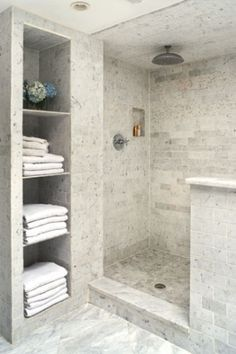 tile shower and niche for linen closet...like this shelf idea. I'd give up closet space for it.