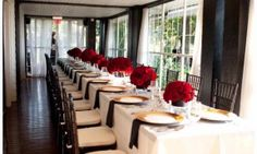 Red roses, black and champagne reception decor