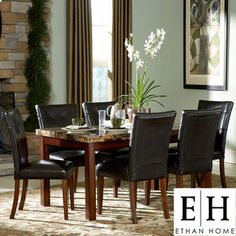 @Overstock - Perk up your dining room up with this stylish cherry dining set that includes an oblong table with a faux-marble top and a beautiful cherry finish. The matching chairs are upholstered in a beautiful faux leather to add comfort and a contemporary style.http://www.overstock.com/Home-Garden/ETHAN-HOME-Hutton-7-piece-Faux-Marble-and-Cherry-Dining-Set/4225077/product.html?CID=214117 $838.99