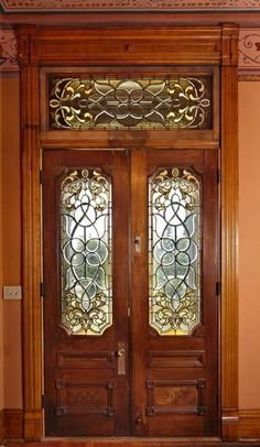 Stained and leaded glass in the double entrance doors also makes its appearance in the upstairs hall and separating the back hall from the sunroom off the port-cochère.