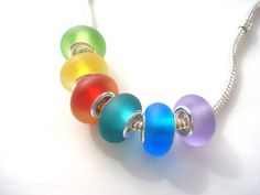 Set of 6 Sea Glass Effect Handmade Lampwork Beads Fits Troll Biagi Pandora style. $39.99, via Etsy.