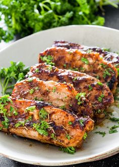 These pork chops are SO tender they melt in your mouth. Since I don't like rosemary I use a tbsp of minced garlic instead. Quick 10 min. prep time and marinade over night. While they bake in the oven whip up some mashed potatoes and a salad, voila dinner is served. That's my kind of …