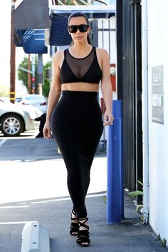 Kim Kardashian wears a black outfit to a Studio City recording studio in Los Angeles on April 2, 2015.   - Cosmopolitan.com