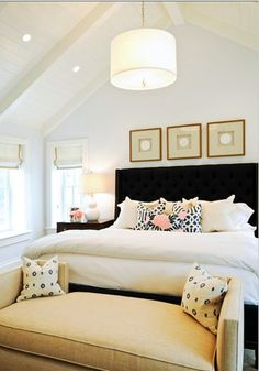 Pop of pink in bedroom with black white tan