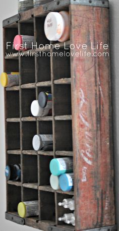 Store art supplies in vintage soda crate