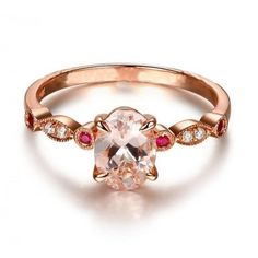 A perfect handmade 1.25 carat Round shape Morganite and Diamond with Ruby engagement ring in 10k Rose Gold. The beautiful women's engagement ring is a perfect designer gemstone ring, handmade and customized to perfection. The glittering and shinning perfect morganite gemstone ring is sure to please her at very first sight.| Price: $399.99 USD on Shygems